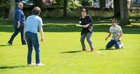 Volunteer playing rounders