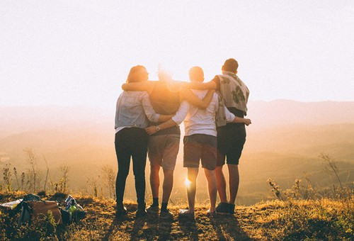 Stock image of a group looking at the sunset