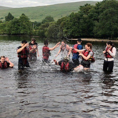 Young people taking part in an outdoor group activity