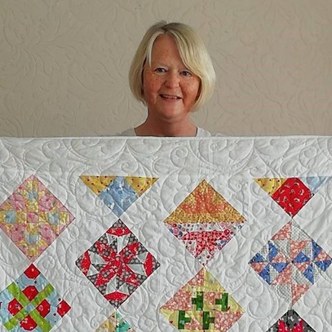 Quaffle winner Carole with her quilt